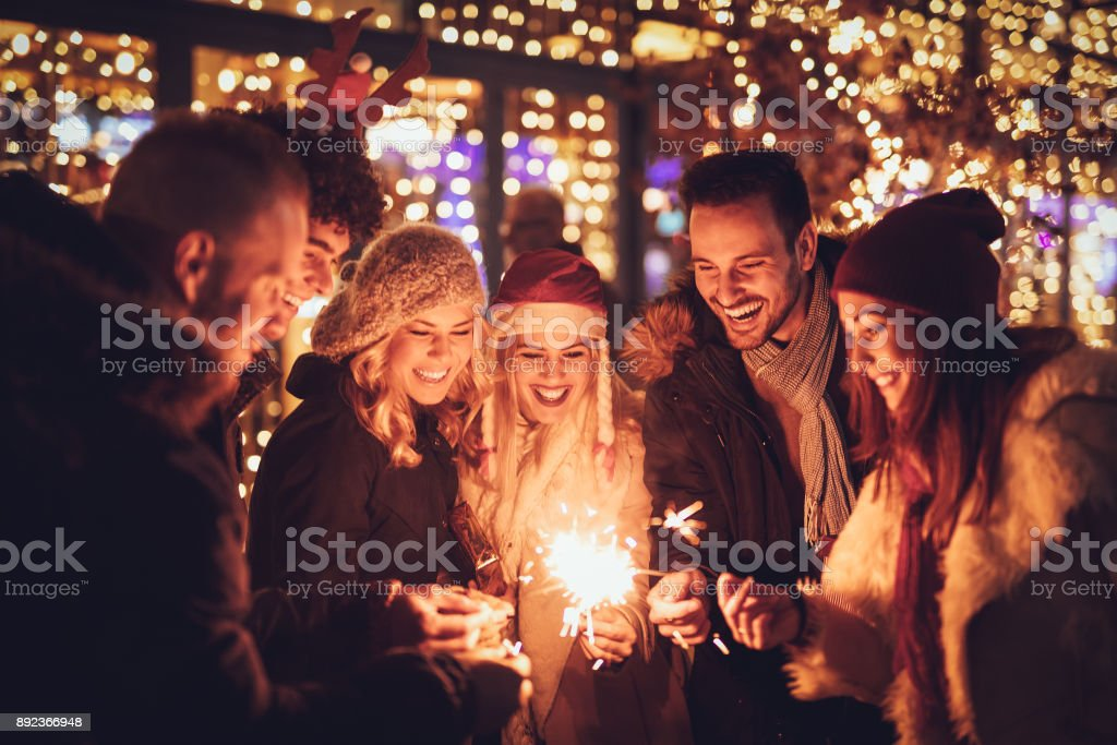 Friends With Sparklers At The New Year Party stock photo