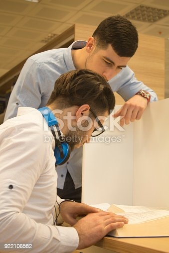 istock Friends working in the course 922106582