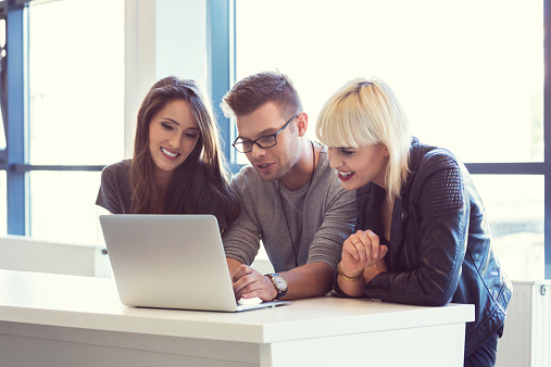Friends Working On Laptop Together Stock Photo - Download Image Now