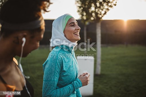 istock Friends working out together 1042425158