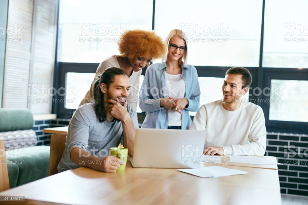 Friends Working Together At Cafe Using Computer Stock Photo Download Image Now Istock