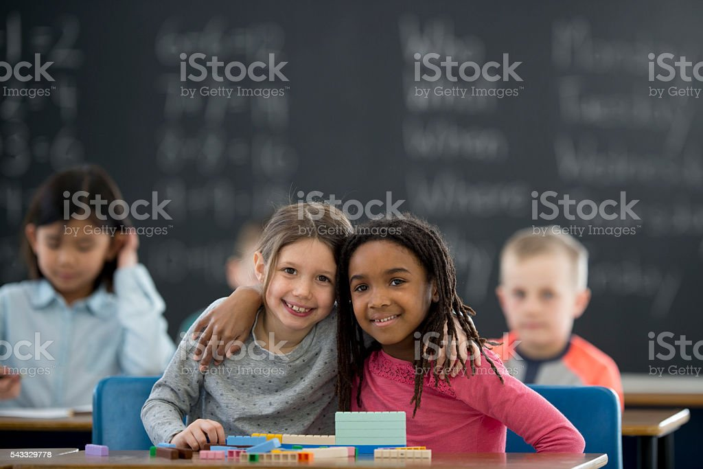 Friends Working Together in Class stock photo