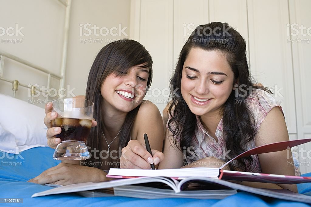 Friends writing in a book royalty-free stock photo