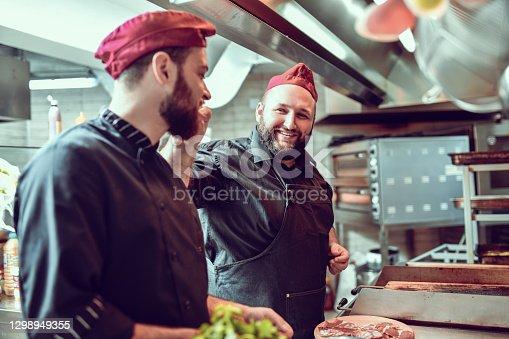 Friendship Between Chef Coworkers In Kitchen