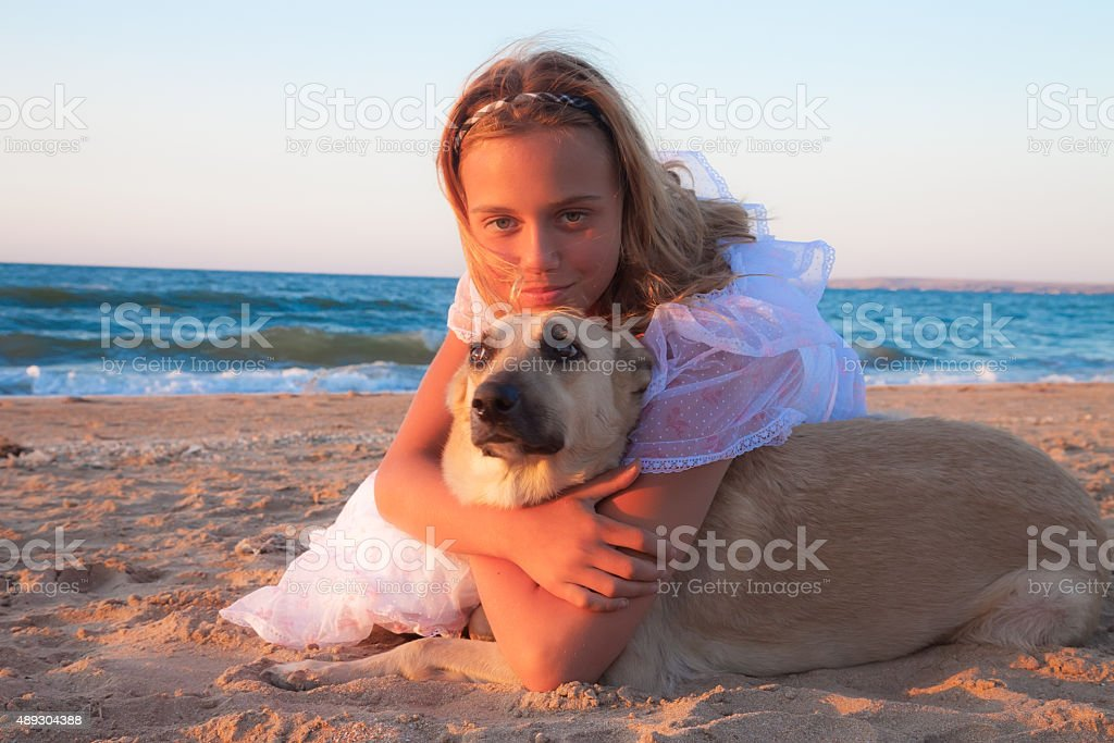 friendship concept girl with her dog lying outdoors stock photo