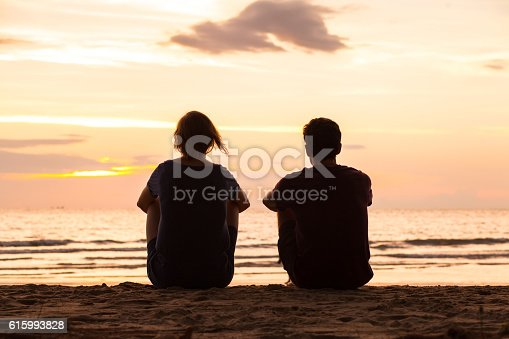 istock friendship, friends sitting together on the beach 615993828