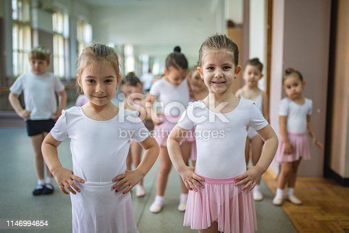 Two cute ballet dancers in a ballet class