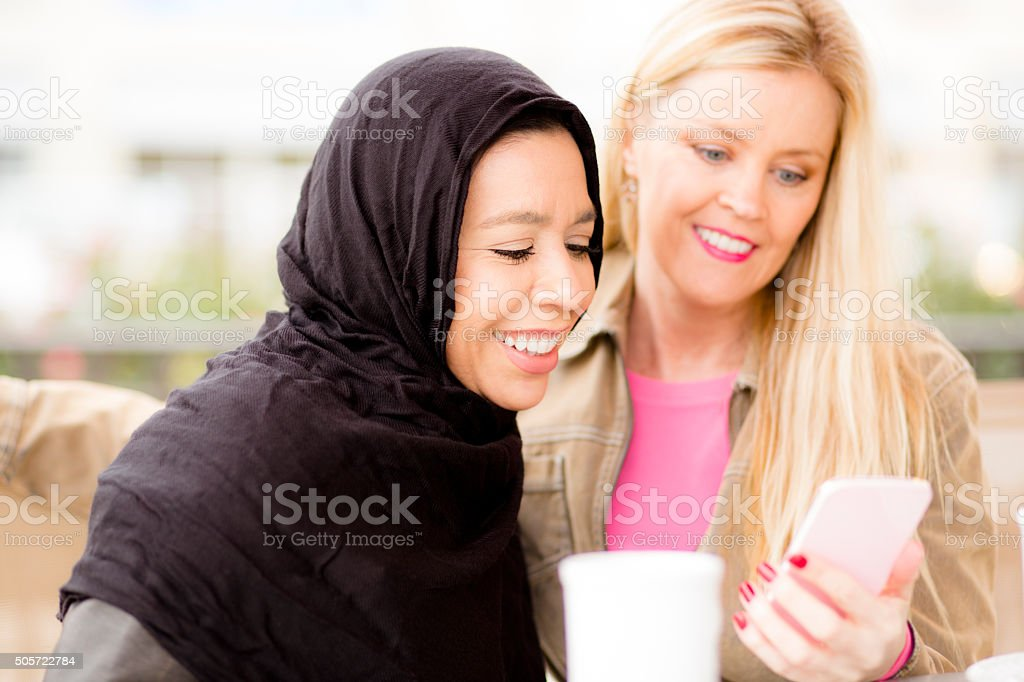 Friendship.  Muslim woman and her friend take selfie. stock photo