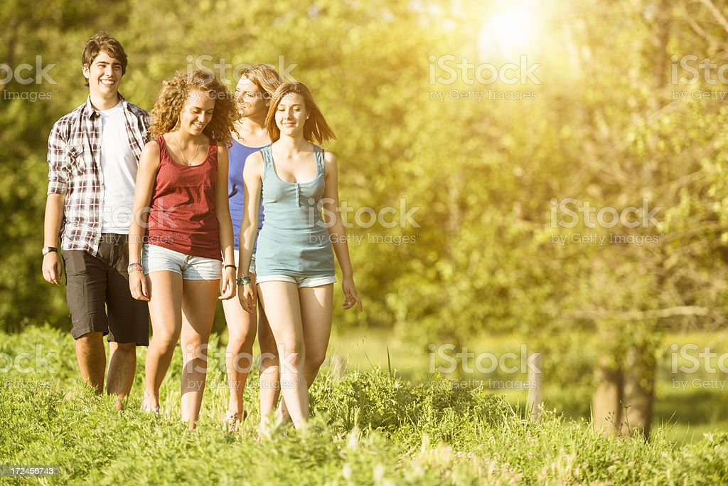 Friendship teenagers walking outdoors royalty-free stock photo