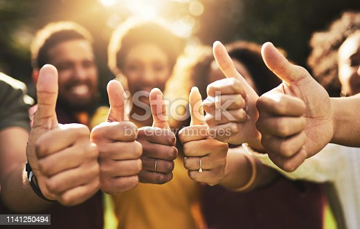Cropped shot of a group of friends showing thumbs up