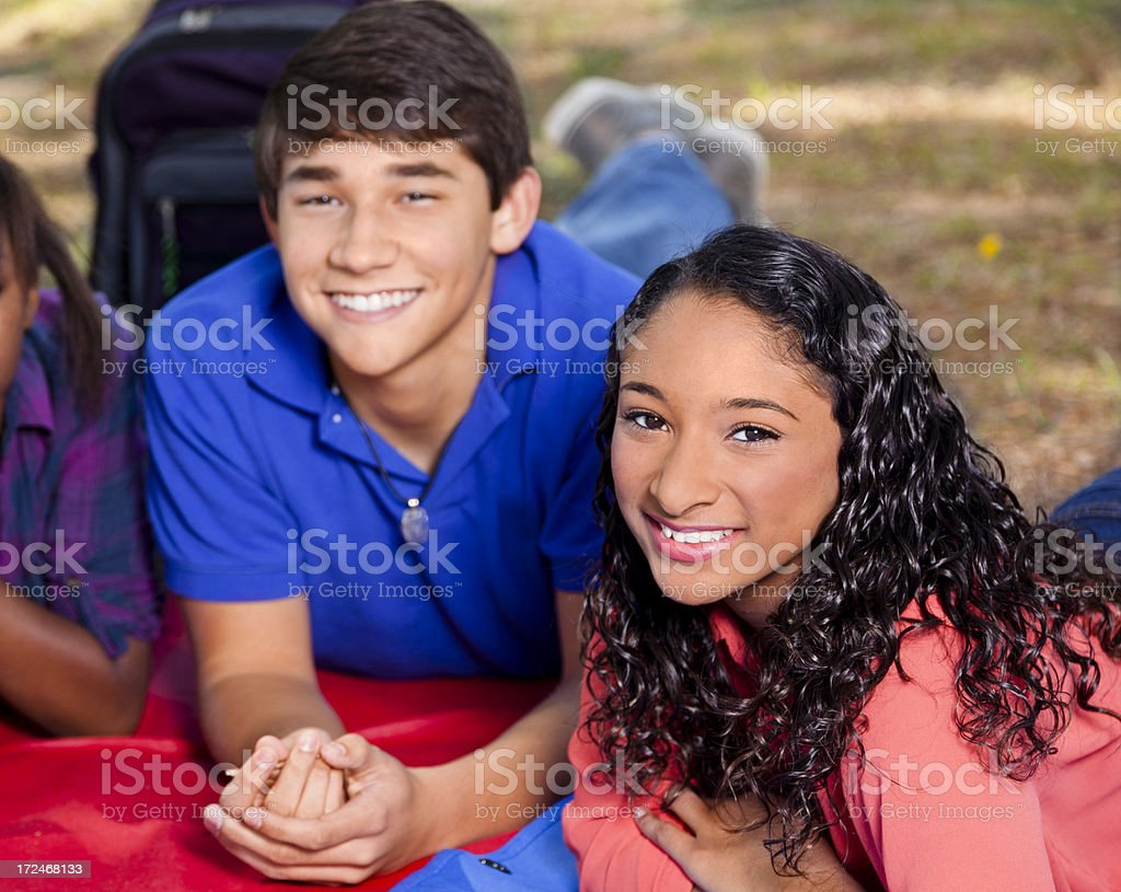 Friendships: Happy teens outside enjoying the spring weather royalty-free stock photo