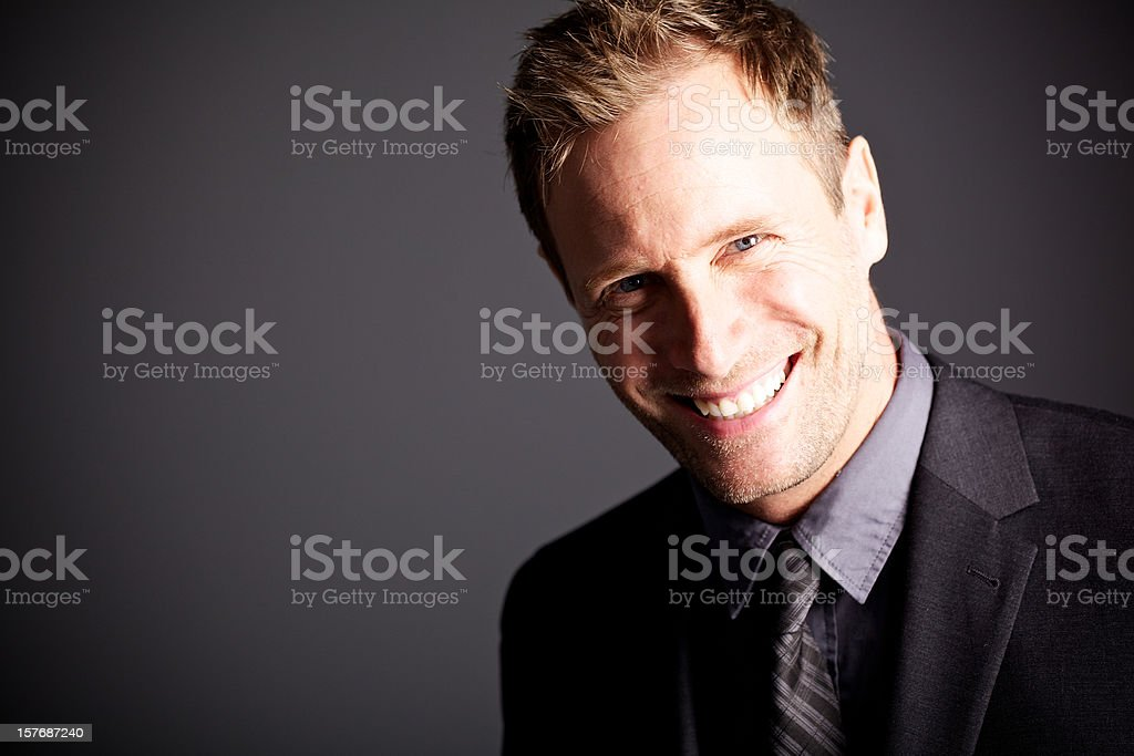 Friendsly businessman smiling royalty-free stock photo