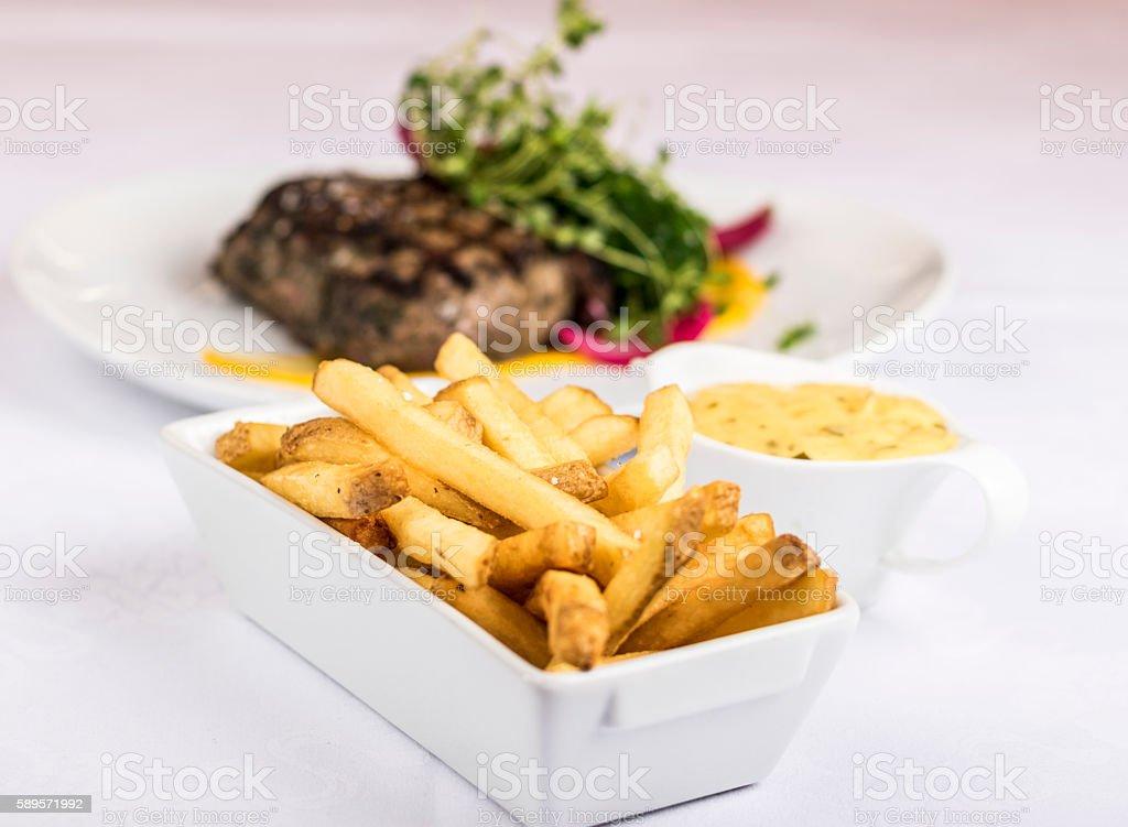 Fries, beef steak and bearnaise sauce stock photo