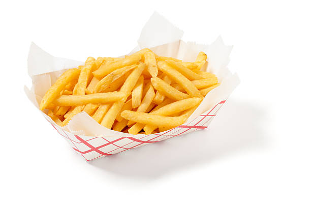 fries in a cardboard tray on a white background - patat stockfoto's en -beelden