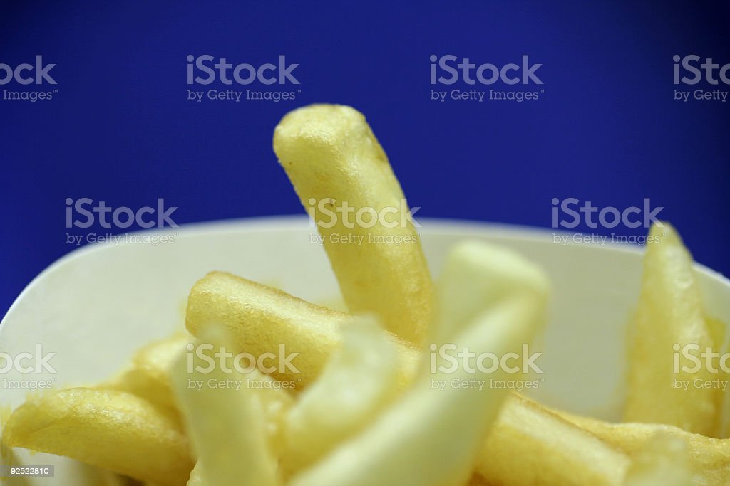 fries over blue royalty-free stock photo