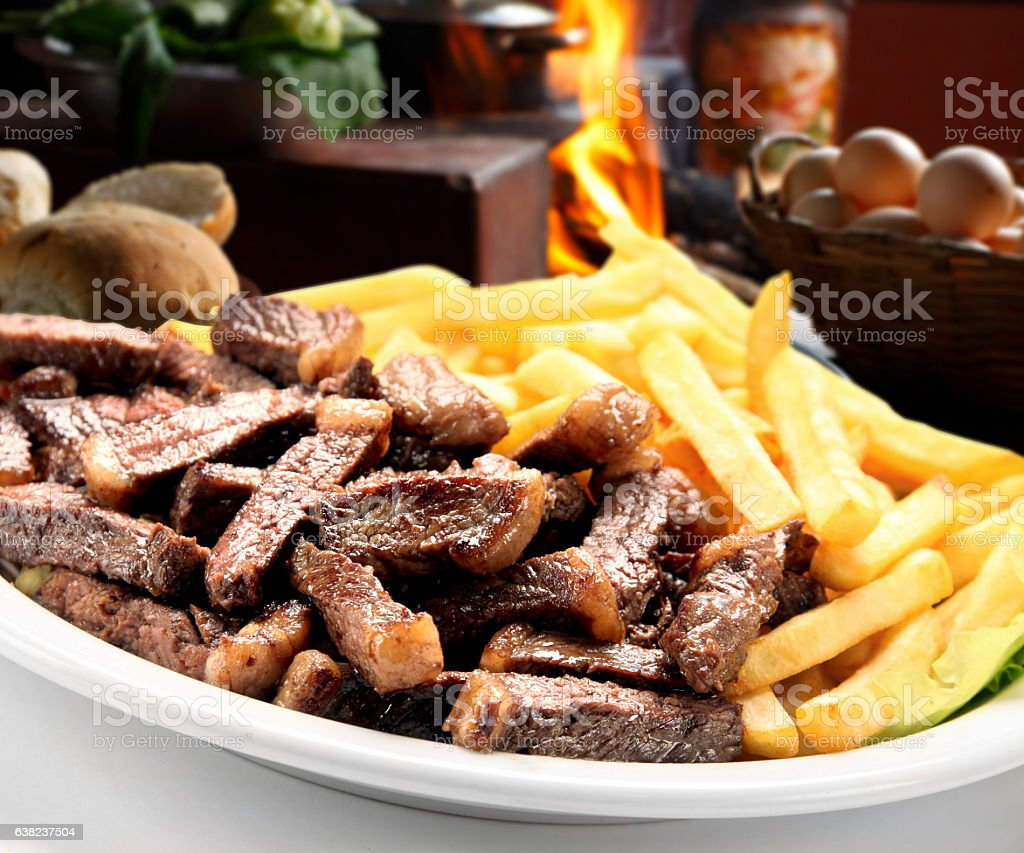 fries with Brazilian picanha stock photo