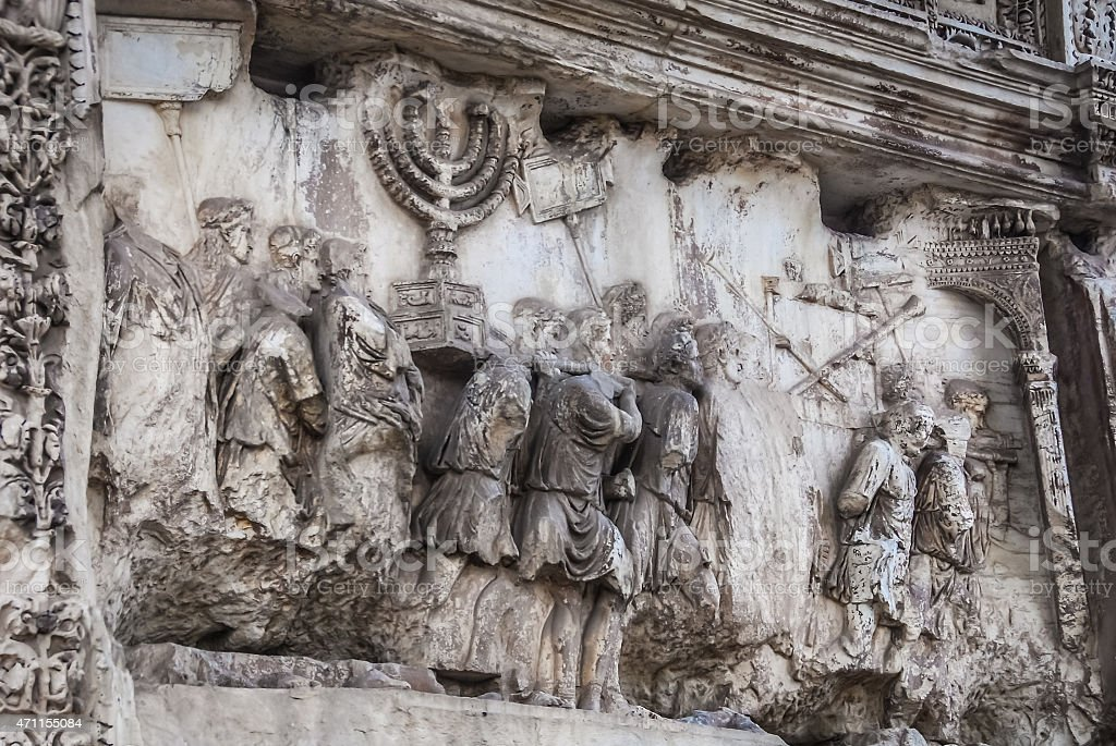 Frieze on the Arch of Titus (Arco di Tito) stock photo