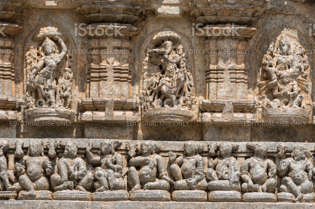 Frieze with statues above at Chennakesava Temple, Somanathpur India. stock photo