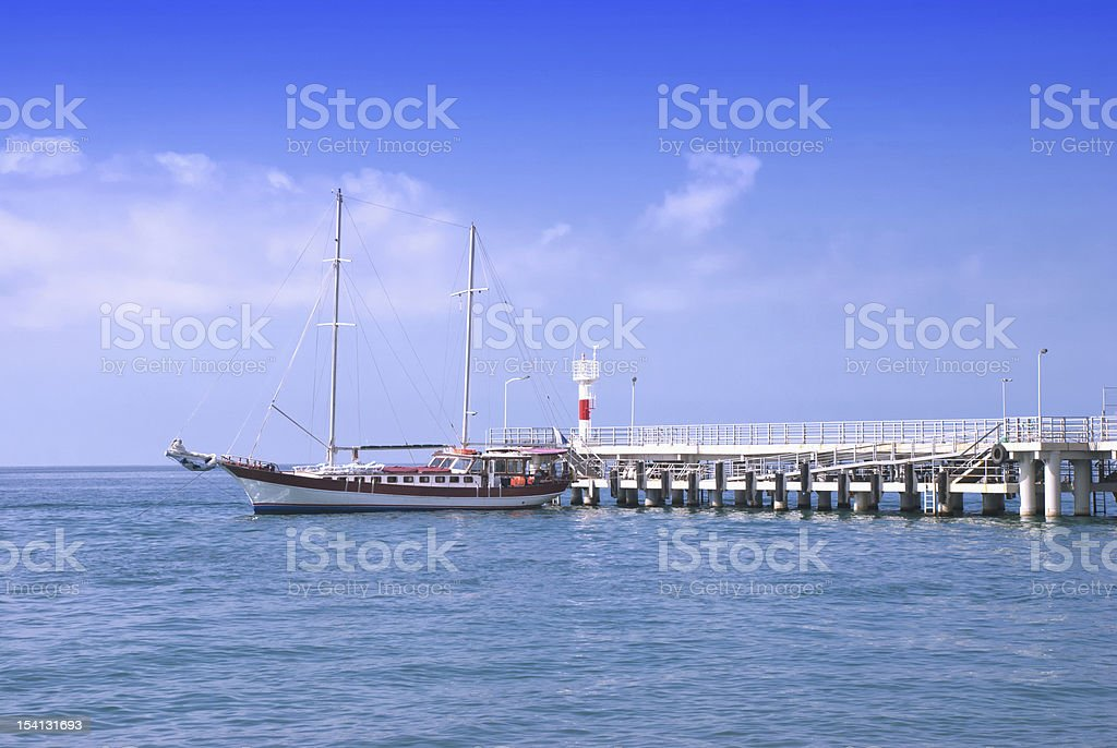 frigate moored to a pier stock photo