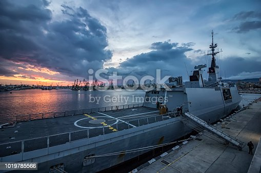 Part of frigate naval forces at sunset at the port. Warship