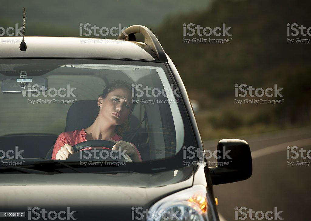 Fright face of woman driving car stock photo