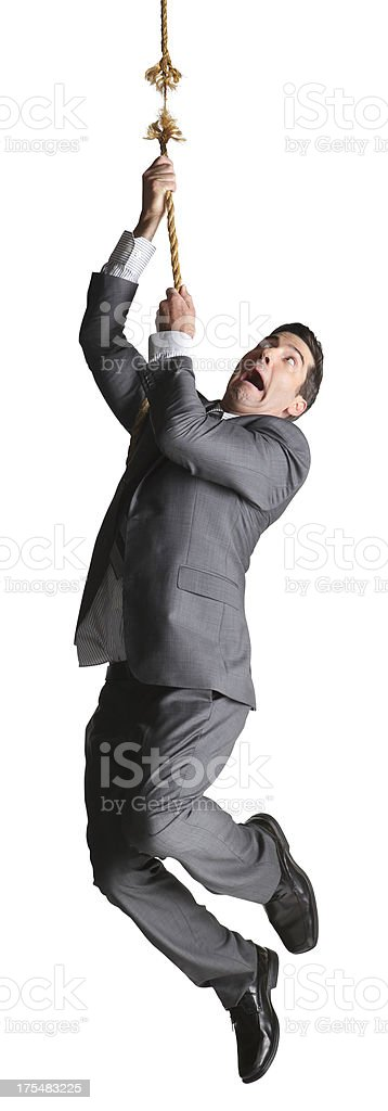 Frightened businessman hanging from frayed rope on white background stock photo