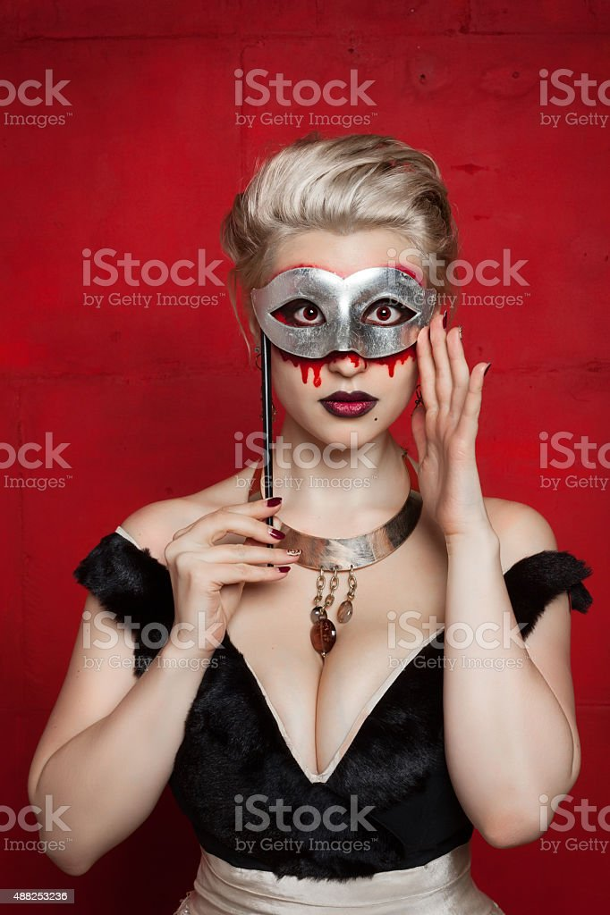 Frightened girl with torn skin on his face stock photo
