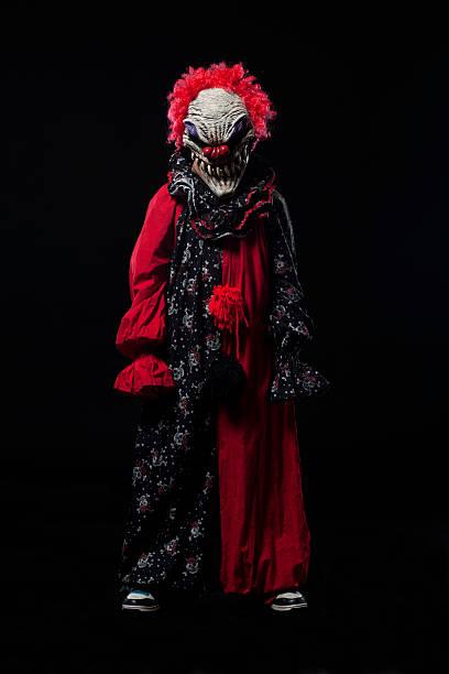 Frightening Clown Halloween Costume Portrait on Black stock photo