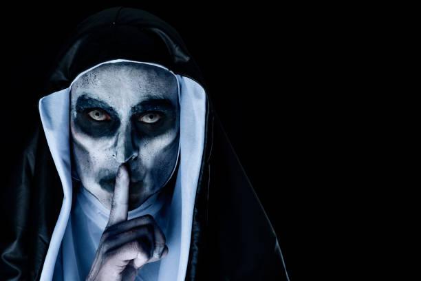 Frightening evil nun asking for silence picture id1049269956?b=1&k=6&m=1049269956&s=612x612&w=0&h=soqmeiimlrurenqj64mjexrriycafds085srmfi0ecc=