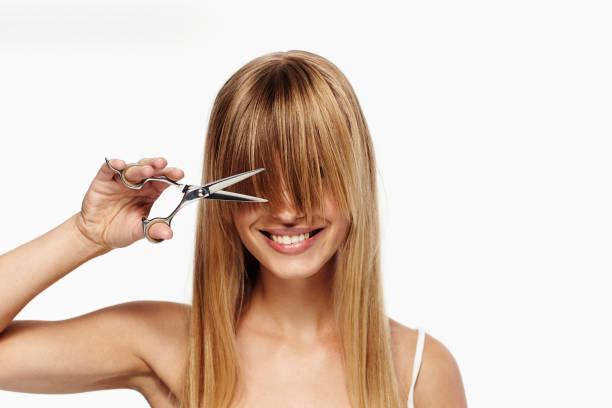 fringe avantages - couper les cheveux photos et images de collection