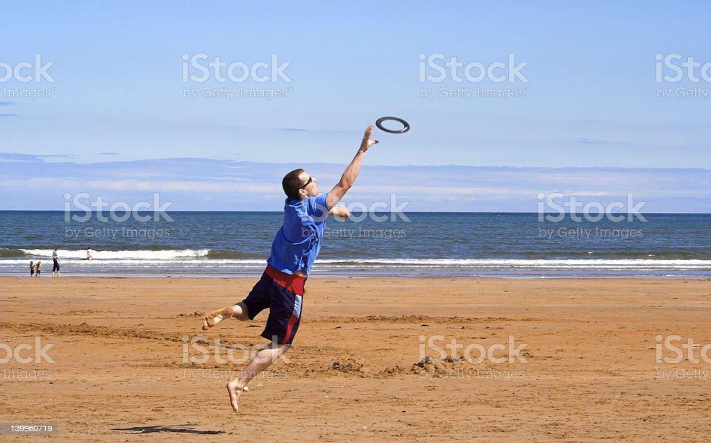 Frisbee leap stock photo