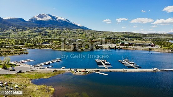 This is an aerial shot, taken by drone over the water of the marina in Frisco, Colorado. Frisco is a beautiful mountain town, situated high in the Colorado Rocky Mountains.