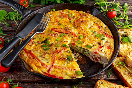 Frittata Made Of Eggs Potato Bacon Paprika Parsley Green Peas Stock Photo - Download Image Now