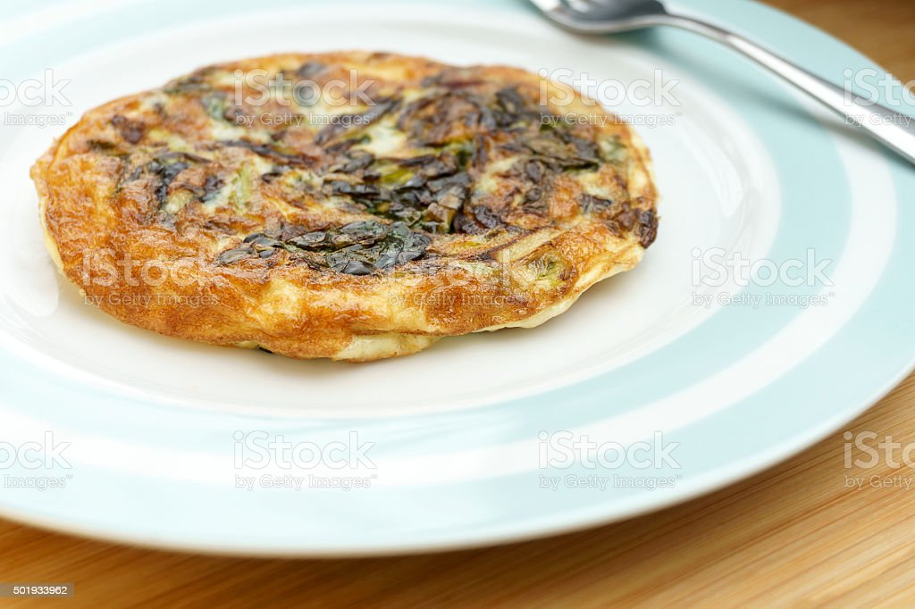 Frittata with onions and cheese. (3/4 view) stock photo