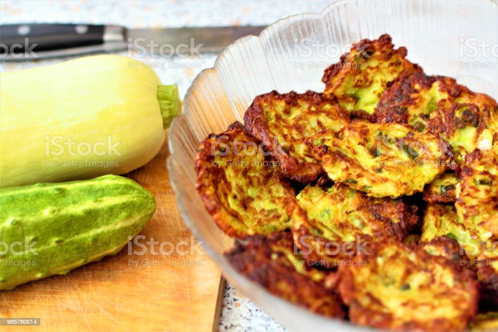 Fritters with fresh vegetables. Zucchini (Cucurbita pepo subsp. Pepo) and cucumber (Cucumis sativus). Add to your diet. Healthy food. - Royalty-free Agriculture Stock Photo