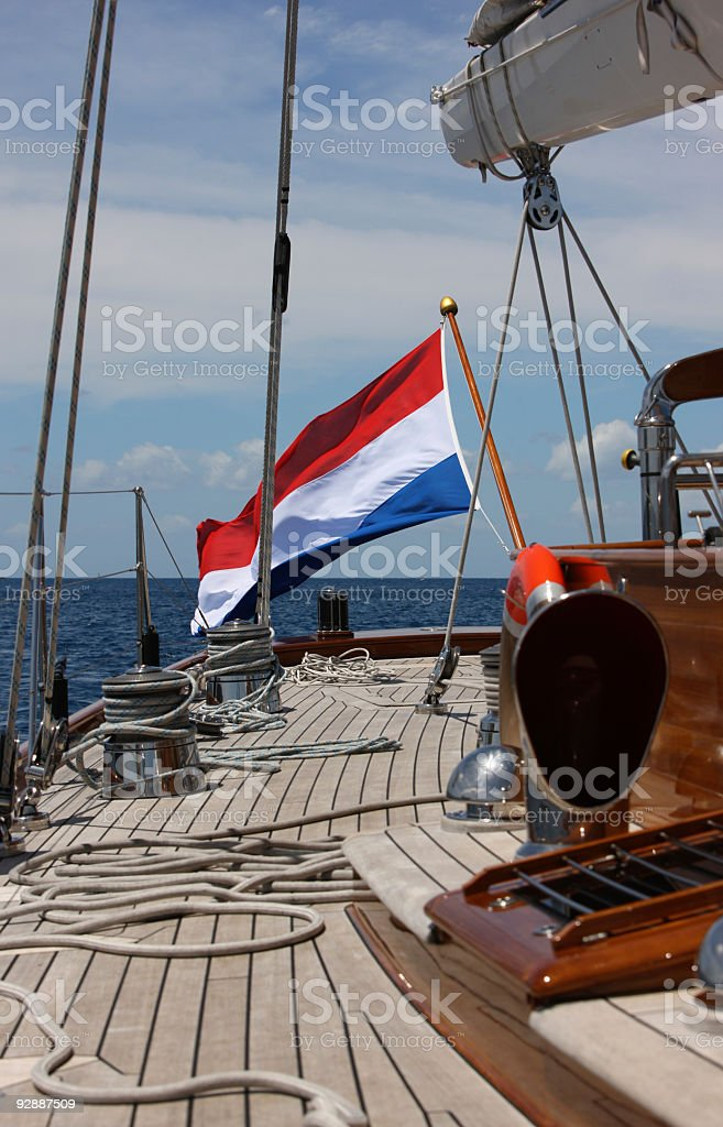 Frеnch flag on the cockpit of luxury sailboat stock photo