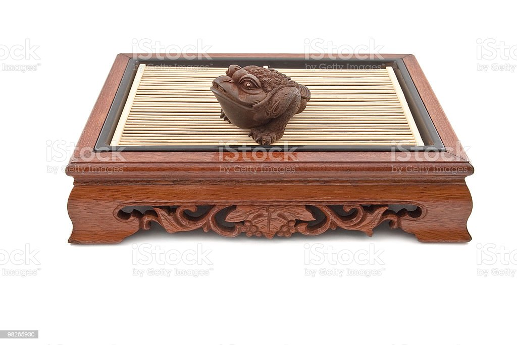 frog figurine on chinese wooden table royalty-free stock photo