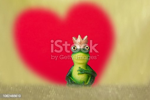frog pirnce with crown in front on red heart