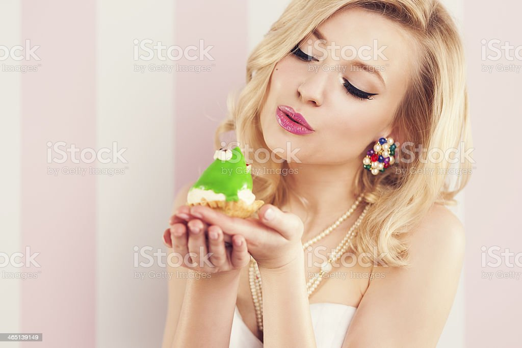 Frog prince being kissed by a beautiful glamour woman stock photo