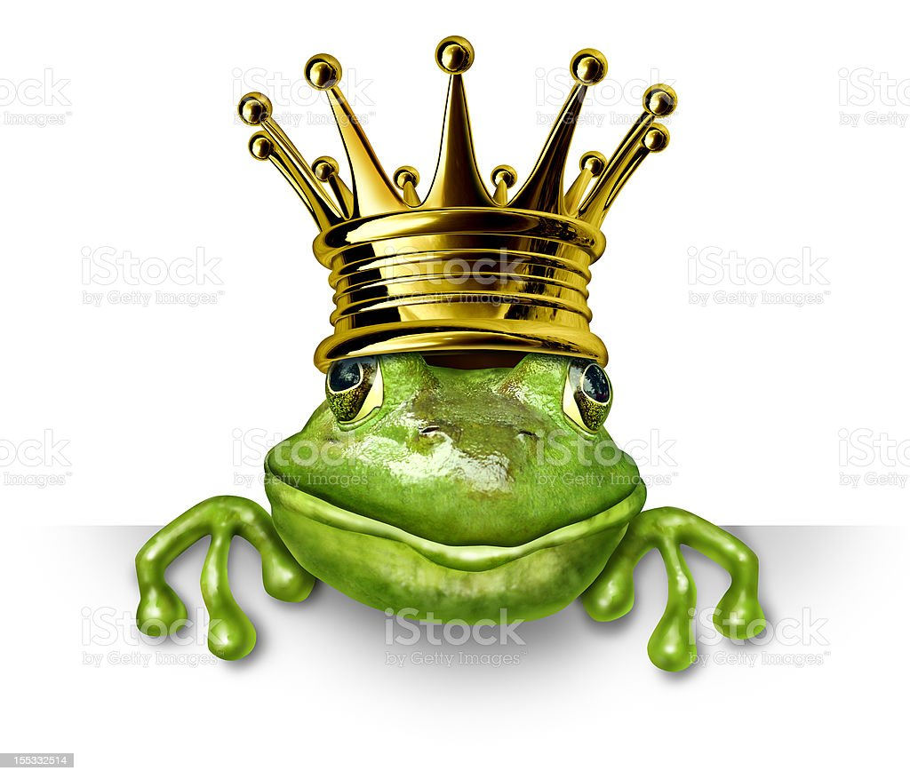 Frog prince with gold crown holding a blank sign stock photo