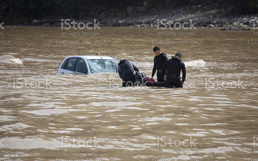 Frogmen recovering motorcycle near sunken car royalty-free stock photo