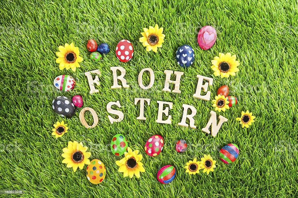 Frohe ostern eggs on grass royalty-free stock photo