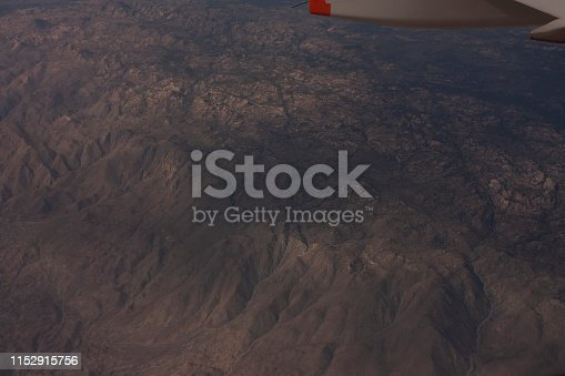 621114928istockphoto From above aerial shot of the mountains before reaching a destination in Mexico 1152915756