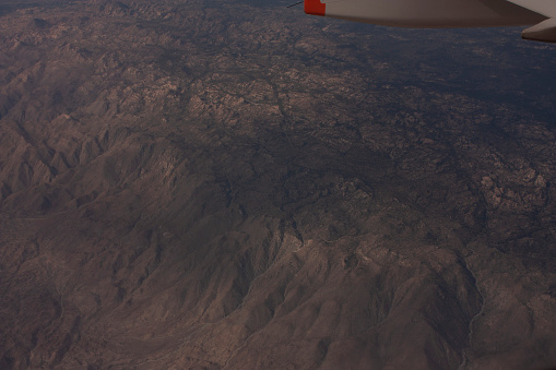 621114928 istock photo From above aerial shot of the mountains before reaching a destination in Mexico 1152915756