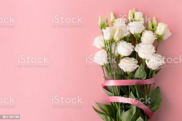 From above bunch of white roses with pink ribbon placed on pink picture id904190786?b=1&k=6&m=904190786&s=612x612&h=lfepmms6kignnlr7xhwyx520zohy1a6qk sdrpyaaus=