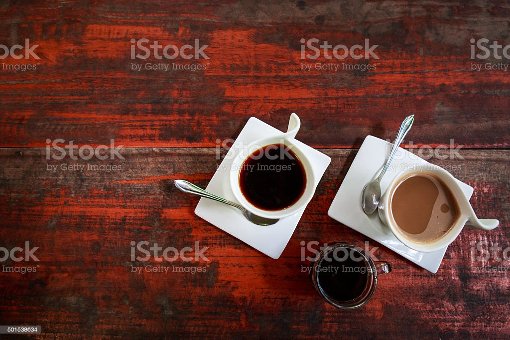 From above coffee mugs on rustic surface with copy space stock photo