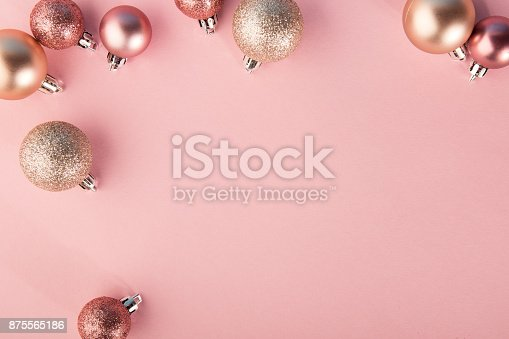 istock From above shot of bright glittering baubles composed in row on pink background. 875565186