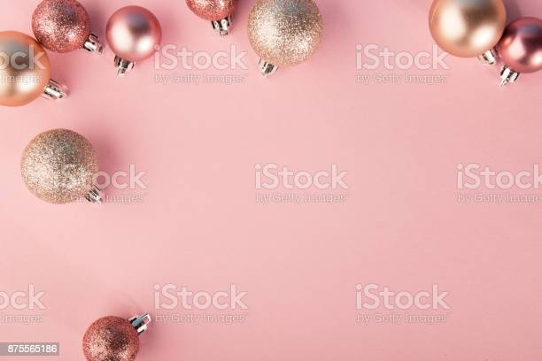 From above shot of bright glittering baubles composed in row on pink picture id875565186?b=1&k=6&m=875565186&s=612x612&h=bnwj3zflekzmk1ra2i9gaev9psvtblx8gihn70t1rlw=