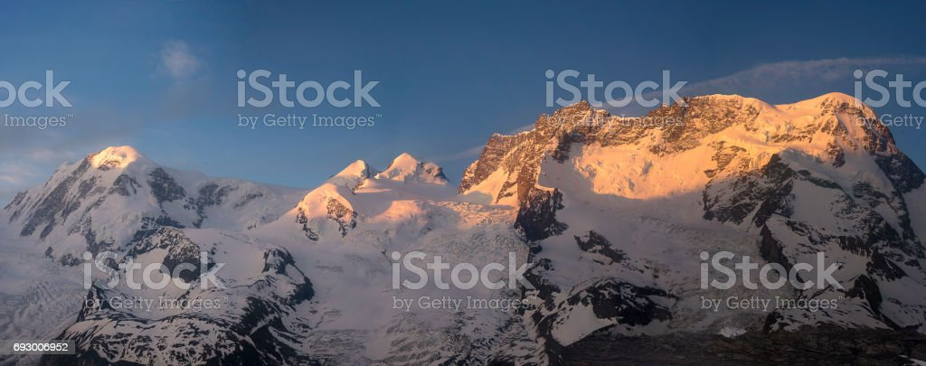 From Breithorn to Lyskam at Sunrise stock photo