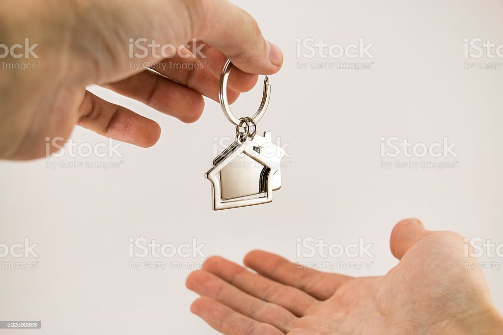 From hand to hand, new apartment property stock photo